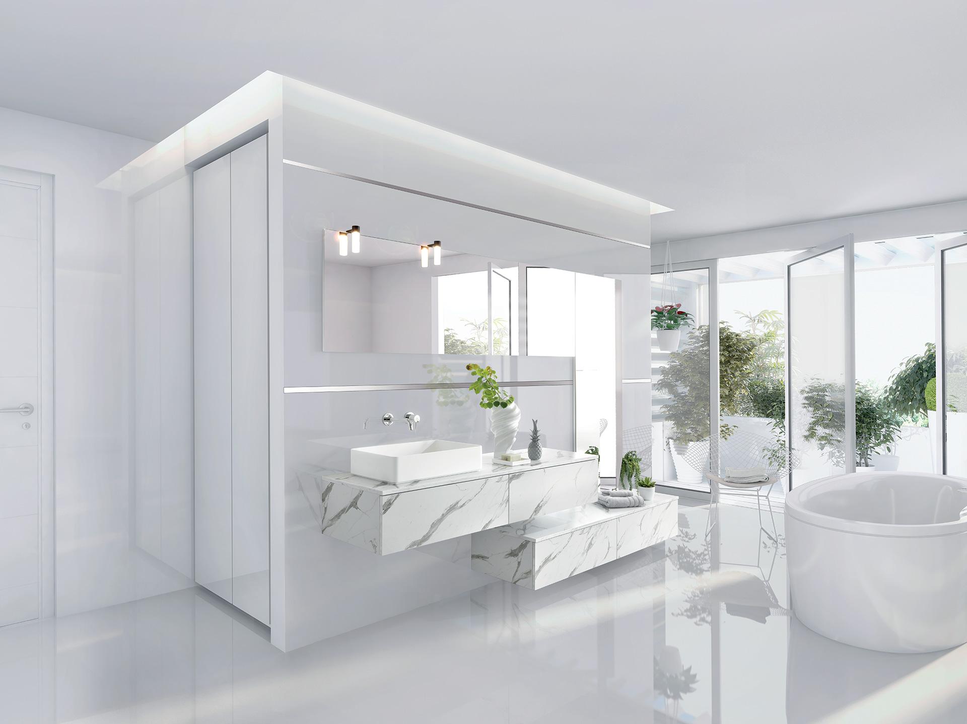 Vue de la salle de bains Arcos Edition coloris gris clair marbré avec l'ensemble bain destructuré, la baignoire ovale, et des plantes vertes.