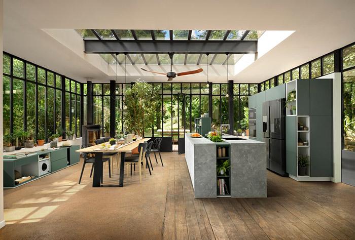 Cuisine avec meubles verts et îlot